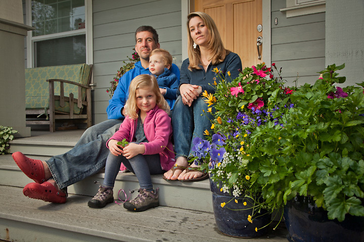 Neighbors, Chris and Ellen Chirichella and children on their porch, South Addition, Anchorage.