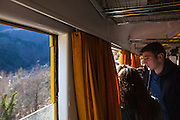 Passengers on the Train Jaune, Yellow Train, Canari, or Ligne de Cerdagne, is a 63km long railway from Villefranche-de-Conflent to Latour-de-Carol, rising from 427m to 1,593m at Bolquère-Eyne, the highest railway station in France. In early 2015 the future of the line was uncertain, with SNCF and the French government considering either to close the line, or to privatise it for tourism use.