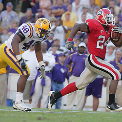 25 October 2008:  Georgia running back Knowshon Moreno (24) runs away from LSU linebacker Darry Beckwith (48) on his way to a third quarter touchdown during the Georgia Bulldogs versus the LSU Tigers game at Tiger Stadium in Baton Rouge, LA.