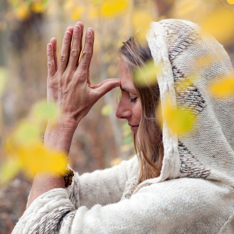 Spiritual woman in yoga meditation outdoors in the autumn woods.