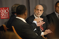Chairman of the Federal Reserve Board of the United States Ben Bernanke (right) listens to Sam Palmisano (left), President and CEO of IBM, at the 'Conversation on the Economy,' a forum held at Pfahl Hall in the Fisher College of Business at Ohio State on Nov. 30, 2010..