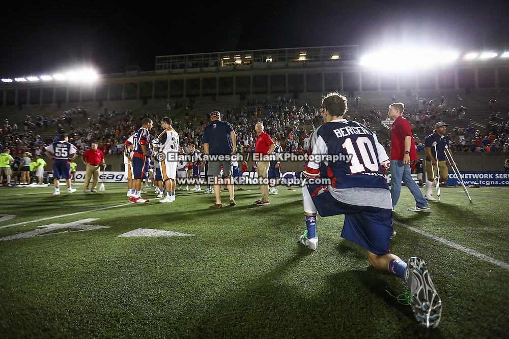 Stephen Berger #10 of the Boston Cannons kneels on the field following the game at Harvard Stadium on August 9, 2014 in Boston, Massachusetts. (Photo by Elan Kawesch)