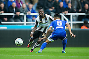 Newcastle United midfielder Christian Atsu (#30) takes on Brentford defender Nico Yennaris (#8) during the EFL Sky Bet Championship match between Newcastle United and Brentford at St. James's Park, Newcastle, England on 15 October 2016. Photo by Craig Doyle.