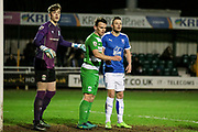 Andy Mangan (Tranmere Rovers) waits for the corner as Rory Watson (on loan from Scunthorpe United) (North Ferriby United) looks on during the Vanarama National League match between North Ferriby United and Tranmere Rovers at Eon Visual Media Stadium, North Ferriby, United Kingdom on 21 March 2017. Photo by Mark P Doherty.