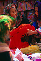 Flower Hmong women shopping for wool in a market in Northern Vietnam.