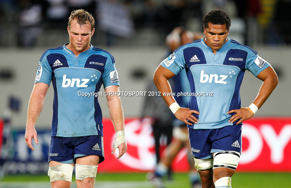 Dejected Blues players Luke Braid (L) and Peter Saili during the Super Rugby game between The Blues and The Sharks at Eden Park, Auckland New Zealand, Friday 13 April 2012. Photo: Simon Watts / photosport.co.nz