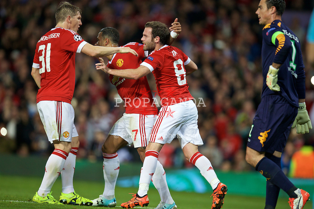 MANCHESTER, ENGLAND - Wednesday, September 30, 2015: Manchester United's Juan Mata celebrates scoring the first goal against VfL Wolfsburg from a penalty kick during the UEFA Champions League Group B match at Old Trafford. (Pic by David Rawcliffe/Propaganda)