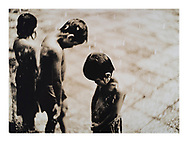 """Boys in the Rain, Angkor Wat, Cambodia, 2001/2005"", £750* GBP.  5/15. Image Size: 23.5cm x 32.2cm, Paper Size: 30cm x 40cm, selenium toned silver gelatin lith print.  Each silver gelatin print has been split-selenium toned using archival methods and is stamped, titled, signed on the reverse. Please email me at info@simon-larbalestier.co.uk for availability and shipping info. All prints are shipped from the United Kingdom. *Stated price does not include shipping."