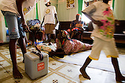Health workers visit a home to vaccinate children during a national polio immunization exercise in Salaga, northern Ghana on Thursday March 26, 2009.