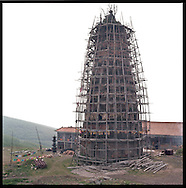 A beautiful and elaborate scaffolding system designed to restore an old temple located on the top of one of the Buddha Mountains.