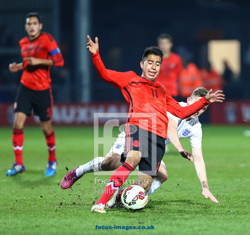 Jose David Ramirez Garcia of Mexico U20 (front) is fouled by Jamie Hanson of England U20 during the International Friendly match at The Hive Stadium, Harrow<br /> Picture by David Horn/Focus Images Ltd +44 7545 970036<br /> 25/03/2015