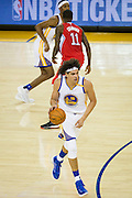 Golden State Warriors center Anderson Varejao (18) dribbles the ball during a NBA preseason game against the Los Angeles Clippers at Oracle Arena in Oakland, Calif., on October 4, 2016. (Stan Olszewski/Special to S.F. Examiner)