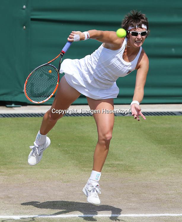 Wimbledon Championships 2014, AELTC,London,<br /> ITF Grand Slam Tennis Tournament,<br /> Yaroslava Shvedova (KAZ),Aktion,Aufschlag,Einzelbild,<br /> Ganzkoerper,Hochformat,von oben,