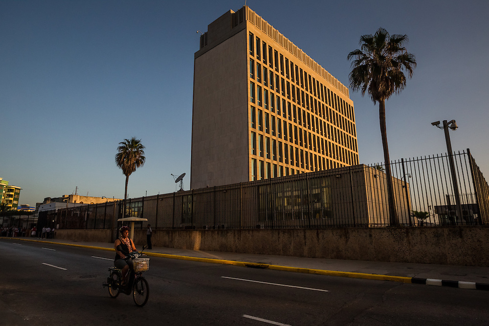 HAVANA, CUBA - JULY 20, 2015: After more than half a century defined by mistrust and rancor, the United States officially reopened its six-story embassy in Havana today, marking a watershed moment of transition for the two countries as they lean toward closer diplomatic ties and ease past one of the last remnants of the Cold War.  President Barack Obama, when announcing an end to the diplomatic freeze, eased travel restrictions, opened the door for more remittances to Cuba and expanded the amount of goods that visiting Americans could bring back home – like Cuban cigars and rum. He even removed the country from the list of nations that sponsor terrorism. President Raul Castro, meanwhile, has spent the last five years, before the thaw even began with the Obama administration, attempting to alter his nation's economic dysfunction, ordering the firing of government employees, encouraging a slow but fresh influx of Cubans into self-employment and even creating a special economic zone in the coastal city of Mariel to attract foreign investment.  PHOTO: Meridith Kohut for The New York Times