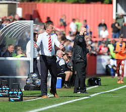 Cheltenham Town Manager, Mark Yates gives directions to his players.  - Photo mandatory by-line: Alex James/JMP - Tel: Mobile: 07966 386802 07/09/2013 - SPORT - FOOTBALL -  Whaddon Road - Cheltenham - Cheltenham Town V Portsmouth - Sky Bet League Two