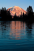 Mount Rainier reflects in the rippled water of Eunice Lake at sunset on a breezy summer evening.