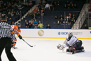 RIT forward Danny Smith scores on a breakaway against Robert Morris goaltender Terry Shafer during the Atlantic Hockey final at the Blue Cross Arena in Rochester on Saturday, March 19, 2016.