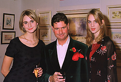 Left to right, MISS OLIVIA HOLCROFT, her father artist HARRY HOLCROFT and MISS SAMANTHA HOLCROFT, at an exhibition in London on 6th November 1997.<br /> MDB 9