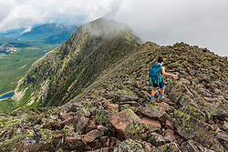 A teenage girl hikes the Knife Edge Trail on Mount Katahdin in Maine's Baxter State Park.
