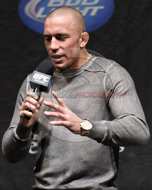 """MANCHESTER, ENGLAND, NOVEMBER 13, 2009: UFC welterweight champion Georges St. Pierre was the speaker at the """"Fight Club"""" fan question and answer session ahead of the weigh-ins for UFC 105 at the MEN Arena in Manchester, England on November 13, 2009."""