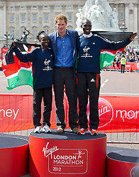 © London News Pictures. 22/04/2012. London, UK. HRH Prince Harry poses with Wilson Kipsang (right) and Mary Keitany of Kenya (left)  who came first in the elite races at the 2012 Virgin London Marathon on April 22, 2012. Photo credit : Ben Cawthra /LNP