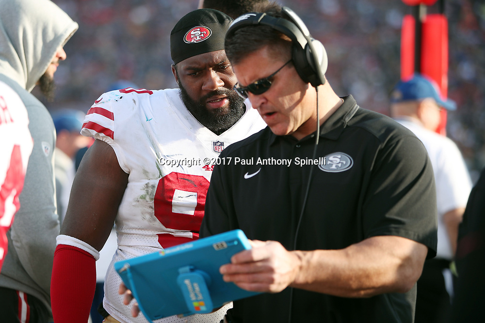 San Francisco 49ers defensive tackle Sheldon Day (96) looks at a play tablet as he talks to a coach on the sideline during the 2017 NFL week 17 regular season football game against the Los Angeles Rams, Sunday, Dec. 31, 2017 in Los Angeles. The 49ers won the game 34-13. (©Paul Anthony Spinelli)