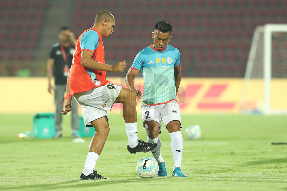 Danilo LOPES CEZARIO of Northeast United FC and Keisham Reagan Singh of Northeast United FC during match 19 of the Hero Indian Super League between NorthEast United FC and Bengaluru FC held at the Indira Gandhi Athletic Stadium, Guwahati India on the 8th December 2017<br /> <br /> Photo by: Ron Gaunt / ISL / SPORTZPICS