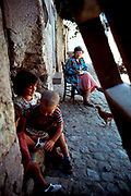 Dr. Mead in Sicily in village of Raffo.  Mead was very interested in child nurses.  What happens to little girls who are responsible for their siblings.  In this photo the child had had enough of being a nurse and was trying to get out on her own.