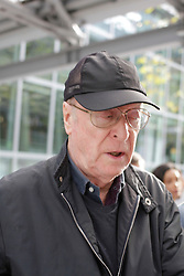 Michael Caine arriving at Heathrow airport,  London, United Kingdom. Friday 22 November 2013. Picture by Mike Webster / i-Images