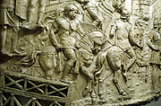 Roman cavalry crossing a wooden bridge: from Trajan's column. Erected by emperor Trajan 106-113 and carved in low relief with narrative of his two campaigns in Dacia. Now topped with statue of St Peter.