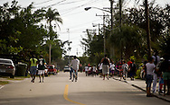 "East Stuart residents and ""Unity in the Community"" barbecue attendees head south on Tarpon Avenue on Feb. 6, 2016, after the end of the event. (XAVIER MASCAREÑAS/TREASURE COAST NEWSPAPERS)"
