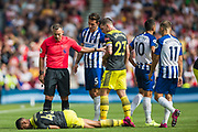 Kevin Friend (Referee) looks at Yan Valery (Southampton) as Florin Andone (Brighton) leaves the pitch during the Premier League match between Brighton and Hove Albion and Southampton at the American Express Community Stadium, Brighton and Hove, England on 24 August 2019.