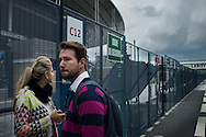 Security measures are being increased at Stade the France prior to Euro 2016 <br /> <br /> Tourists Liliane Bellenzier and Guilherme Tenfen from Santa Maria, Brasil outside the Stade de France. They wanted to see the stadium, but the newly built security fence prevented them from getting inside.<br /> <br /> Photographer Chris Maluszynski /MOMENT/INSTITUTE