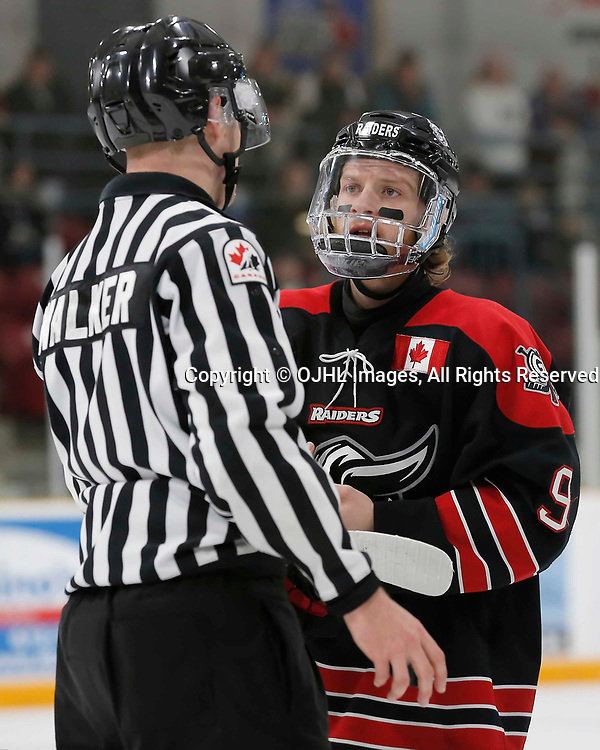 TRENTON, ON  - MAY 2,  2017: Canadian Junior Hockey League, Central Canadian Jr. &quot;A&quot; Championship. The Dudley Hewitt Cup. Game 1 between Dryden GM Ice Dogs and the Georgetown Raiders. Jordan Crocker #9 of the Georgetown Raiders talks to OHA Linesman Walker  <br /> (Photo by Amy Deroche / OJHL Images)