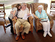 From left, Hailey Mann, 7, hugs her grandfather Harvey Kratz, 97, as he sits with her grandmother Mae Kratz, 96  Sunday April 17, 2016 in Hatfield, Pennsylvania. They celebrate their 80th wedding anniversary on Monday April 18th, 2016. The couple has 3 children, 9 grandchildren, 16 great grandchildren and 6 great great grandchildren. (Photo by William Thomas Cain)