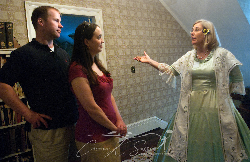 Kevin Pugh and Nicole Pugh listen as Marti Ross gives a tour at Twelve Gables in Columbus, Miss. April 16, 2010. The 1838 home  was among nearly two dozen on tour during Columbus' annual Spring Pilgrimage. (Photo by Carmen K. Sisson/Cloudybright)