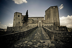 Melfi/Basilicata/Italy - The Castle. The Castle, dominating the whole town. It was probably constructed ex novo by the Normans (11th century), as no traces of pre-existing Byzantine or Lombards edifices have been found. Originally, it was probably a simple rectangle with square towers, with further towers defending the main gate. One of the main internal buildings was later (16th-18th centuries) turned into a baronal palace by enclosing the walls between the towers within new walls. Under the Angevine rule a new section was added one the slope descending to the Melfia stream, with several construction rising at different altitudes. The Castle was chosen by King Charles I's wife, Beatrice of Provence, as her residence. The Aragon kings gave it to the Caracciolo dynasty of the Caracciolo Candida family lineage (descendents of the House of Candia and the Caracciolo House), who rebuilt the side facing the city and dug a moat. Later it was a possession of the powerful House of Doria.