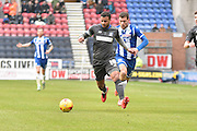 Bury Midfielder, Tom Soares leads the chase for the ball during the Sky Bet League 1 match between Wigan Athletic and Bury at the DW Stadium, Wigan, England on 27 February 2016. Photo by Mark Pollitt.