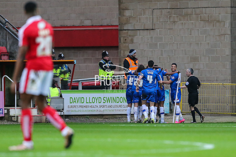 Gillingham celebrate their 2nd goal of the match during the Sky Bet League 1 match between Swindon Town and Gillingham at the County Ground, Swindon, England on 26 December 2015. Photo by Shane Healey.