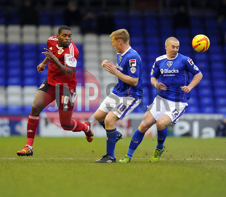 Bristol City's Jay Emmanuel-Thomas battles for the ball with Oldham Athletic's Adam Lockwood and Oldham Athletic's David Mellor - Photo mandatory by-line: Joe Meredith/JMP - Tel: Mobile: 07966 386802 08/02/2014 - SPORT - FOOTBALL - Oldham - Boundary Park - Oldham Athletic v Bristol City - Sky Bet League One