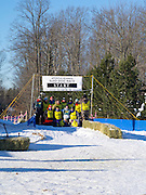 Volunteers gather at the starting line for a group photo. Scenes from the Apostle Islands Sled Dog Race, hosted by the Bayfield Chamber of Commerce, near Bayfield, WI