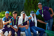Ashgabat, Turkmenistan - 2017 September 19: Men rests on the bench at the Olympic Sport Complex while 2017 Ashgabat 5th Asian Indoor & Martial Arts Games on September 19, 2017 in Ashgabat, Turkmenistan.<br /> <br /> Mandatory credit:<br /> Photo by © Adam Nurkiewicz<br /> <br /> Adam Nurkiewicz declares that he has no rights to the image of people at the photographs of his authorship.<br /> <br /> Picture also available in RAW (NEF) or TIFF format on special request.<br /> <br /> Any editorial, commercial or promotional use requires written permission from the author of image.