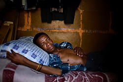 Goodman Kaye lies in his bed in a small shack in Wadela, a mining community outside of Johannesburg. He has HIV and TB.   Once a miner has contracted TB the disease can lie in wait for more than 10 years until the patient's immune system is weakened and the disease becomes active.  South African Gold miners are particularly vulnerable to contracting TB because of the small, poorly ventilated work conditions, high rates of TB and high rates of silicosis, a lung disease often found in miners that increases the chance of catching TB.