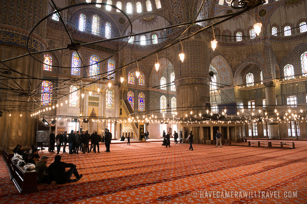 The ornate decorations inside the prayer hall of Istanbul's Blue Mosque. While it is widely known as the Blue Mosque for the its interior tiling, the mosque's formal name is Sultan Ahmed Mosque (or Sultan Ahmet Camii in Turkish). It was built from 1609 to 1616 during the rule of Sultan Ahmed I.
