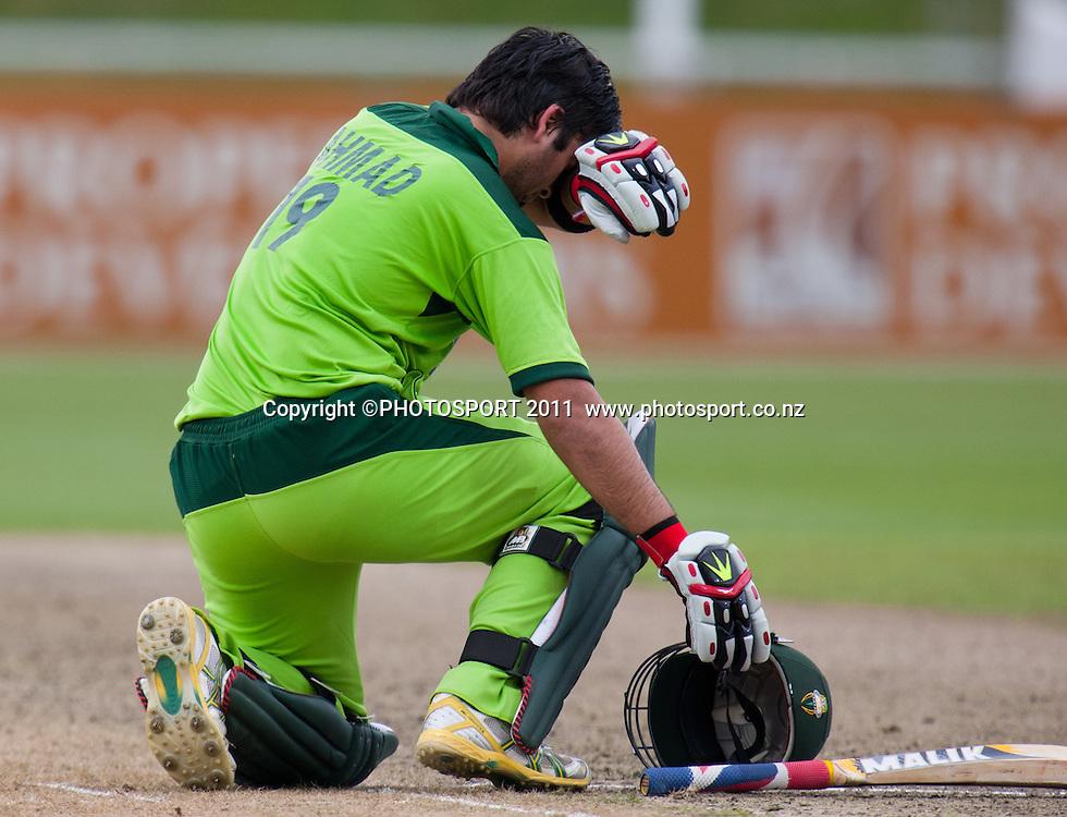 Ahmed Shehzad brings up his century during the 5th ODI, Black Caps v Pakistan, One Day International Cricket at Seddon Park, Hamilton, New Zealand. Thursday 3 February 2011. Photo: Stephen Barker/PHOTOSPORT