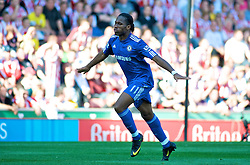 STOKE, ENGLAND - Saturday, September 12, 2009: Chelsea's Didier Drogba celebrates scoring the equalising goal against Stoke City during the Premiership match at the Britannia Stadium. (Pic by Gareth Davies/Propaganda)