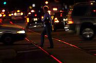 Pedestrian crossing the light rail tracks in downtown Sacramento.