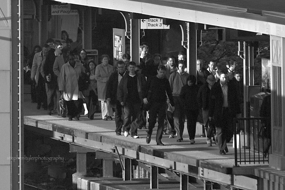 Evening commuters arriving at Yonkers Station after days' work.