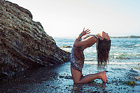 Woman experiencing yoga on the seashore.<br /> :::<br /> &quot;Embrace each of your senses in turn;<br /> Seeing as being touched by light.<br /> Hearing as immersion in an ocean of sound.<br /> Tasting as enlightening.Smelling as knowing.<br /> Touching as electrifying.<br /> Then leave all these behind,<br /> Enter the spaciousness of the heart,<br /> Intimate with the unknowable.&quot;<br /> -The Radiance Sutras translated by Lorin Roche