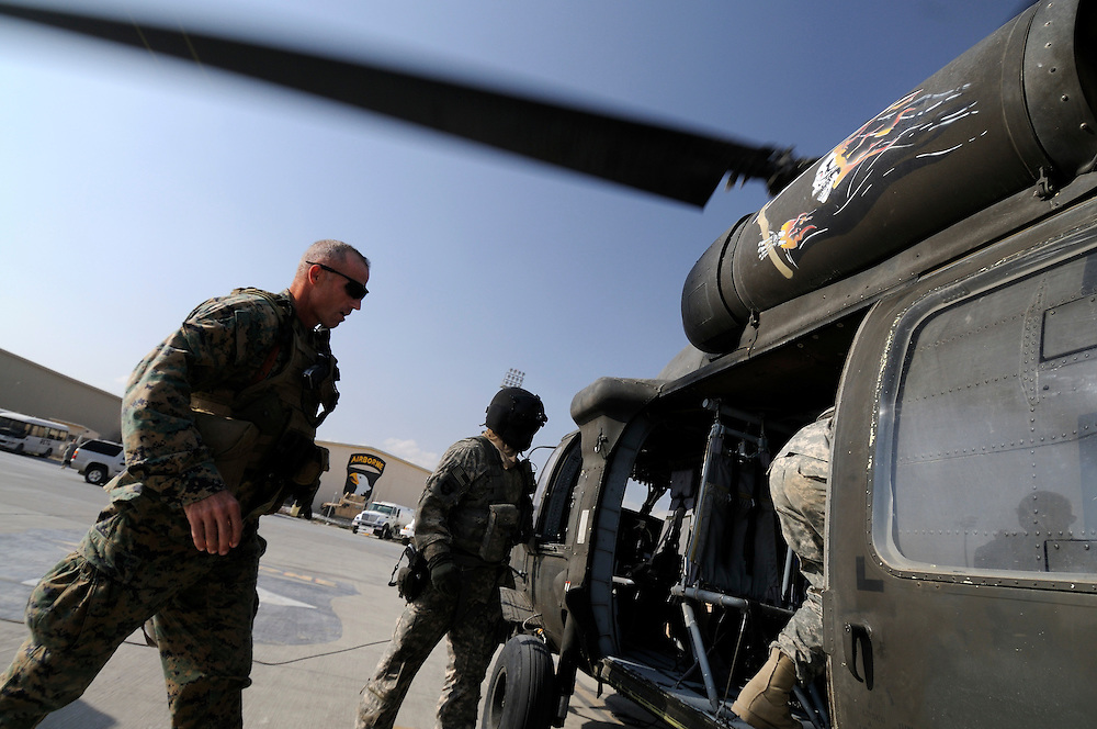 US Marine Colonel Jeff Haynes, Commanding Officer, 201st Regional Corps Advisory Command, boarding a Black Hawk helicopter after a counterinsurgency meeting at Bagram Air Base.  He met with Generals from the Afghan, Pakistan and US militaries.